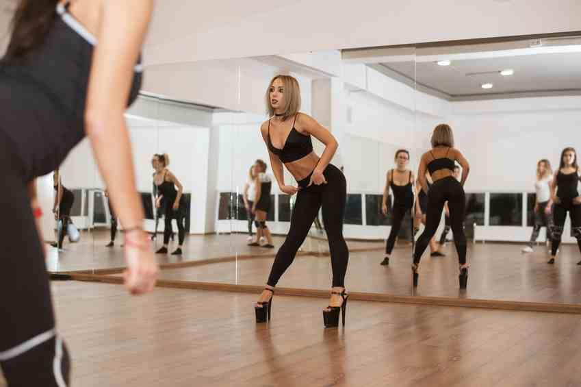 Trainer explaining striptease dancing